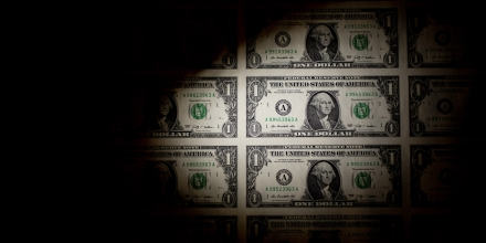 A sheet of uncut U.S. $1 bills is arranged for a photograph in Washington, D.C., U.S., on Thursday, Feb. 6, 2014. A suspension of the federal debt limit, enacted by Congress in October, is scheduled to expire Feb. 7. Treasury Secretary Jacob J. Lew has urged lawmakers to act quickly to raise the cap, saying the government