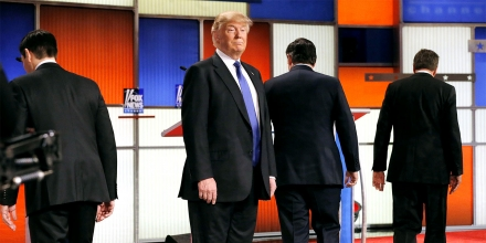 Republican U.S. presidential candidate Donald Trump remains standing at the front of the stage as rivals Marco Rubio (L), Ted Cruz (2nd R) and John Kasich (R) head to their podiums at the start of the U.S. Republican presidential candidates debate in Detroit, Michigan, March 3, 2016. REUTERS/Jim Young (TPX IMAGES OF THE DAY)   (Newscom TagID: rtrlseven684612.jpg) [Photo via Newscom]