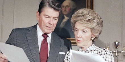 President Ronald Reagan and Mrs. Nancy Reagan go over their joint address which they will give to the nation, at the White House in Washington on Sept. 13, 1986. The address, which will be seen nationally on Sunday, will focus on the war against drug abuse. (AP Photo/Charles Tasnadi)