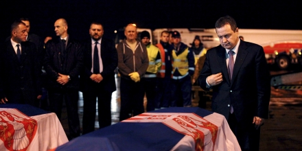 Serbian Foreign Minister Ivica Dacic (R) stands next to the coffins of two Serbian embassy staff abducted in Libya, at Belgrade's Nikola Tesla airport, Serbia, February 23, 2016. REUTERS/Djordje Kojadinovic (Newscom TagID: rtrlseven658773.jpg) [Photo via Newscom]