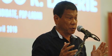 Presidential candidate Mayor Rodrigo Duterte addresses some country's business leaders during a forum on Wednesday, April 27, 2016 at the financial district of Makati city in Manila, Philippines. The tough-talking Duterte, the mayor of the southern Philippine city of Davao, is the front-runner leading to the May 9 presidential elections. (AP Photo/Bullit Marquez)