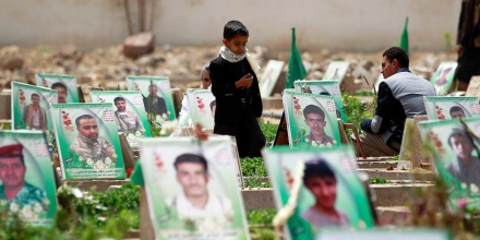 Yemenis visit the grave of relatives reportedly killed during Saudi-led military coalition air strikes against Huthi rebels at a cemetary in Sanaa, on March 25, 2016. Despite the Saudi-led coalition military operation in Yemen entering its second year on March 26, 2016 the Shiite rebels are yet to be weakened and still control much of the country, where the humanitarian crisis is worsening. The UN says civilians account for more than half of the about 6,300 people killed in the conflict in the last year. / AFP / MOHAMMED HUWAIS (Photo credit should read MOHAMMED HUWAIS/AFP/Getty Images)