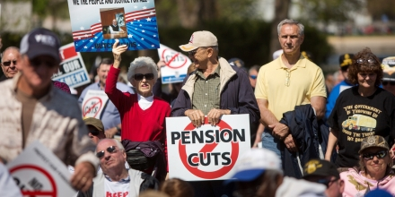 WASHINGTON, D.C. - APRIL 14: Attendees rally on the West Front of the U.S. Capitol building with Teamsters Union retirees who traveled from across the country to voice their opposition to deep cuts to their pension benefits on April 14, 2016, in Washington, D.C. Thousands are facing massive pension cuts because of a law called the Multiemployer Pension Reform Act of 2014 (MPRA). (Photo by Allison Shelley/Getty Images)