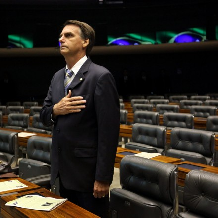 epa04149938 Legislator Jair Bolsonaro, who supports the dictatorship, participates in a session held at Chamber of Legislators in Brasilia, Brazil, 01 April 2014. Brazilian Chamber of Legislators abruptly stoped the session in rejection of the 50 year anniversary of the military coup at the moment that Bolsonaro wanted to start his speech. Members of Parliament jeered at him and turned their backs in way of protest.  EPA/FERNANDO BIZERRA JR. (Newscom TagID: epalive129917.jpg) [Photo via Newscom]