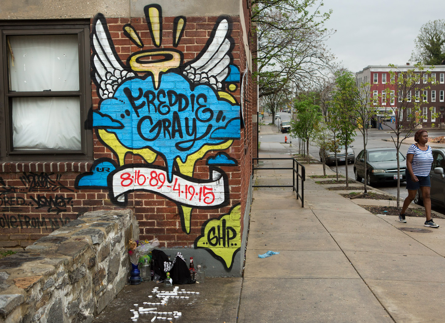 A memorial to Freddie Gray, who died while in police custody just over one year ago, stands at the spot where he was picked up by police in Baltimore, Maryland, April 23, 2016.  (photo by Allison Shelley)