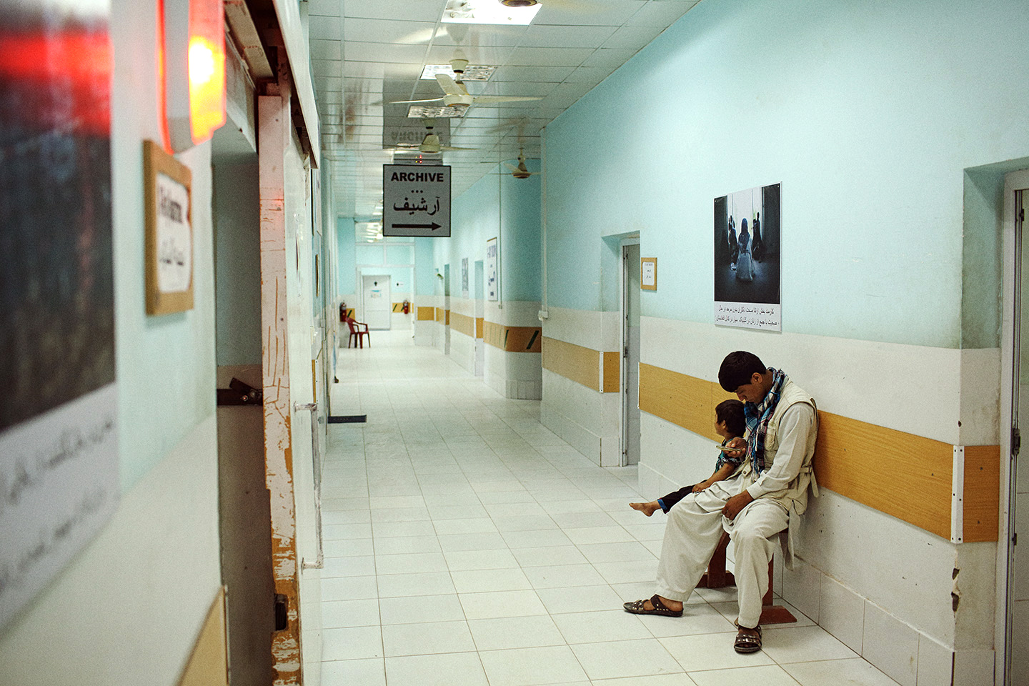 A young patient waits to be X-rayed with her father at Medicines Sans Frontieres (MSF) Kunduz Trauma Center where free treatment is provided to patients regardless of their political affiliation (ie. the side on which the fight in the war between the Taliban and Government forces) and gives precedence to those wounded as a result of war.