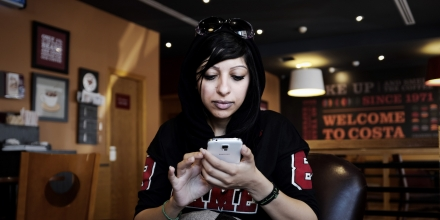 Bahraini human rights activist Zainab al-Khawaja, sister of jailed prominent rights activist Maryam al-Khawaja, sits at a cafe near the Bahrain court building after she was barred by authorities from attending the hearing, in the capital Manama on September 6, 2014. A Bahrain court ruled that Maryam al-Khawaja be kept behind bars for an extra 10 days despite a UN call for her release, her lawyer said. AFP PHOTO/MOHAMMED AL-SHAIKH        (Photo credit should read MOHAMMED AL-SHAIKH/AFP/Getty Images)