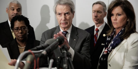 WASHINGTON, DC - MARCH 12: U.S. Rep. Walter Jones (R-NC), center, speaks during a press conference with Emanuel Lipscomb, from left, a survivor of the World Trade Center terrorist attack, Sylvia Carver, whose sister died in the September 2001 attack, U.S. Rep. Stephen Lynch (D-MA), and Terry Strada, whose husband died in the September 2001 attack, to voice support for U.S. House bill H.R. 428 in the Cannon House Office Building on March 12, 2014 in Washington, DC. The bill would make public 28 pages, currently classified, that were removed from the congressional investigation's report on the terrorist attacks on September 11, 2001. (Photo by T.J. Kirkpatrick/Getty Images)