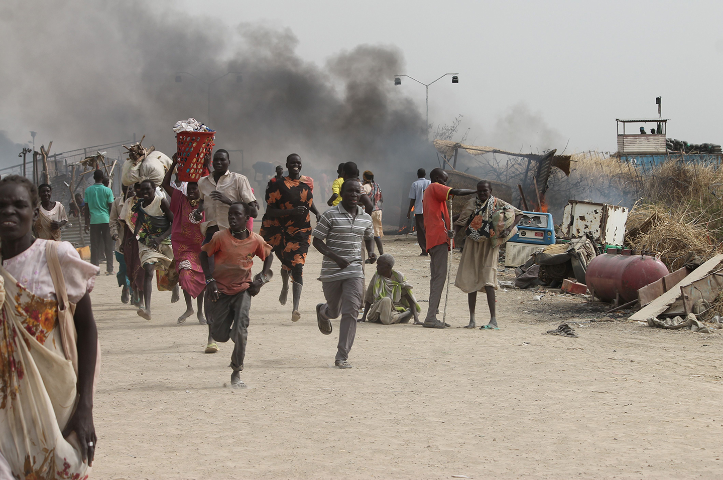 TOPSHOT - South Sudanese civilians flee fighting in an United Nations base in the northeastern town of Malakal on February 18, 2016, where gunmen opened fire on civilians sheltering inside killing at least five people.</p> <p>Gunfire broke out in the base in Malakal in the northeast Upper Nile region on February 17, 2016 night, with clashes continuing on Thursday morning that left large plumes of smoke rising from burning tents in the camp which houses over 47,000 civilians.<br />  / AFP / Justin LYNCH        (Photo credit should read JUSTIN LYNCH/AFP/Getty Images)