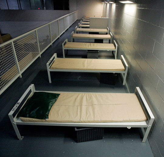 FILE - This Dec. 10, 2008, file photo shows a row of beds at the Elizabeth Detention Facility, a Corrections Corporation of America immigration facility in Elizabeth, N.J. CCA, the largest contractor for U.S. Immigration and Customs Enforcement, reached a preliminary agreement in May 2010, to soften confinement, free of charge, at nine immigrant facilities covering more than 7,100 beds. ICE officials see the deal, which includes Elizabeth, as a precursor to changes elsewhere. (AP Photo/Mel Evans, File)