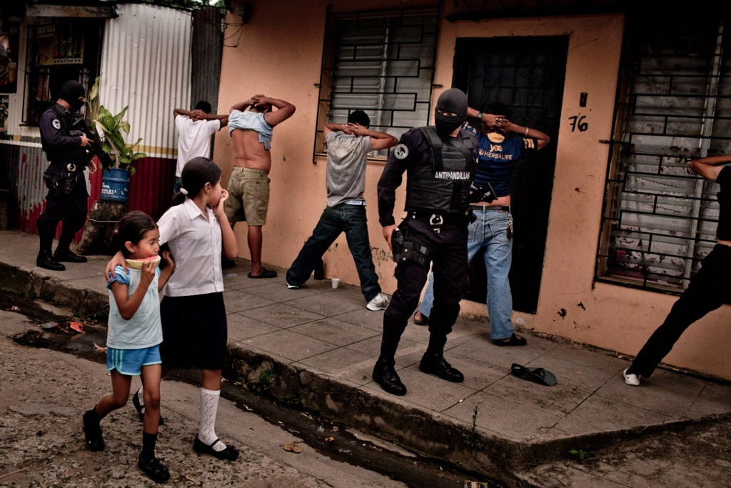 Members of a police anti-gang force search men in San Salvador, El Salvador. Aug. 14, 2012. Authorities believe peace talks involving the two largest street gangs in the country, the Mara Salvatrucha and Barrio 18, have led to a precipitous drop in violence in El Salvador, one of the hemisphere's most violent countries. (Tomas Munita/The New York Times)