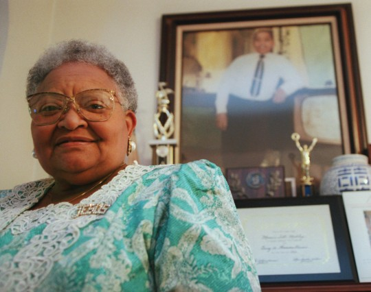 Mamie Till Mobley stands before a portrait of her slain son, Emmett Till, in her Chicago home on July 28, 1995. Since Emmett's lynching 40 years ago, Mobley has been committed to making sure that his death is remembered and never repeated. Till was kidnapped, tortured and lynched for allegedly whistling at a white woman in a small Mississippi town. (AP Photo/Beth A. Keiser)