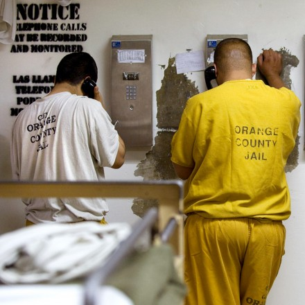 May 24, 2011 - Santa Ana, California, U.S. - Inmates make collect phone calls which could be monitored and recorded at the Sheriff's Central Men's Jail Tuesday. Local officials expect the county jails to fill as inmates remain in county facilities longer following California's release of prisoners from state facilities. ....///ADDITIONAL INFO:   H. LORREN AU JR., THE ORANGE COUNTY REGISTER.   - 5/24/11 - s.prisonrelease.0524.ots -  Photographed in the Intake Release Center and Men's Central Jail in Santa Ana.   A 1 million contract the county has entered in with ICE could also be in question. (Credit Image: © H. Lorren Au Jr/The Orange County Register/ZUMAPRESS.com)