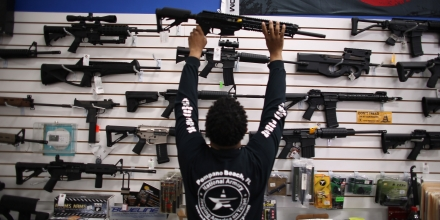 POMPANO BEACH, FL - APRIL 11:  As the U.S. Senate takes up gun legislation in Washington, DC , Mike Acevedo puts a weapon on display at the National Armory gun store on April 11, 2013 in Pompano Beach, Florida. The Senate voted 68-31 to begin debate on a bill that would significantly expand background checks for gun sales.  (Photo by Joe Raedle/Getty Images)