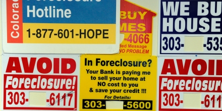 Signs posted on the wall at the offices of the Colorado Foreclosure Hotline Tuesday morning. The Colorado Foreclosure Hotline is a free service, those posted on the wall charge a percentage. Andy Cross, The Denver Post  (Photo By Andy Cross/The Denver Post via Getty Images)
