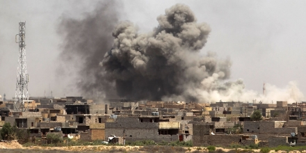 Smoke billows from Fallujah's southern Shuhada neighbourhood following shelling during an operation by Iraqi government forces, backed by air support from the US-led coalition, to regain control of the area from the Islamic State (IS) group on June 13, 2016.Iraq's elite counterterrorism service moved to within three kilometres of central Fallujah and consolidated positions in the south of the city, the operation's commander Lieutenant General Abdelwahab al-Saadi said. / AFP / AHMAD AL-RUBAYE (Photo credit should read AHMAD AL-RUBAYE/AFP/Getty Images)