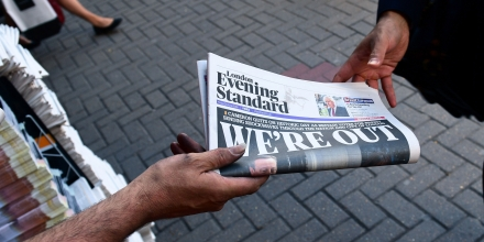 A man takes a copy of the London Evening Standard with the front page reporting the resignation of British Prime Minister David Cameron and the vote to leave the EU in a referendum, showing a pictured of Cameron holding hands with his wife Samantha as they come out from 10 Downing Street, in London on June 24, 2016. Britain voted to break away from the European Union on June 24, toppling Prime Minister David Cameron and dealing a thunderous blow to the 60-year-old bloc that sent world markets plunging. / AFP / LEON NEAL (Photo credit should read LEON NEAL/AFP/Getty Images)