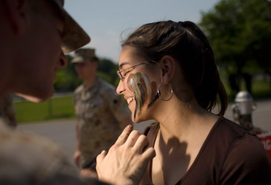 Applying camouflage,   US Marines event,  Orchard Beach,   Bronx, NY, 2007.