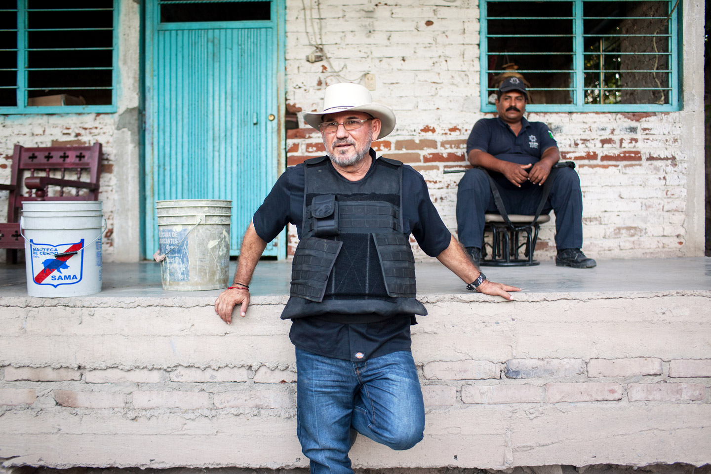 """Hipolito Mora rests at his families lime ranch in La Ruana, Michoacán, Mexico, Tuesday, December 15, 2015. Hipolito Mora was one of the original founder of the autodefensa movement, which saw vigilantes spread across the state of Michoacán and drive out the cartel group the 'Knights of Templar'. Since the uprising began in 2013, other criminal groups have filled the space of the previous cartel and many look at the autodefensa movement as a failure. Mora has had many challenges over the last three years, including being sent to jail twice and having his son killed in a shootout Dec. 16, 2014 during a shootout with a rival group.  This ranch is a very important place for Mora. """"This is where I expect to die"""" said Mora, motioning to the hills surrounding the ranch, which would make for a great spot for a shooter to hide. """"My son and I had plans to build up the house and make this out place, it was out dream, but that was before."""" (Brett Gundlock/Boreal Collective)"""