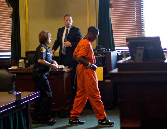 Juwan Wickware, 19, is escorted out of the court room during his sentencing by Genesee Circuit Judge Archie Hayman at the Genesee County Court House on Friday, July 26, 2013. The next round of witnesses are scheduled for Friday, August 9, 2013. (AP Photo/The Journal, Zack Wittman)
