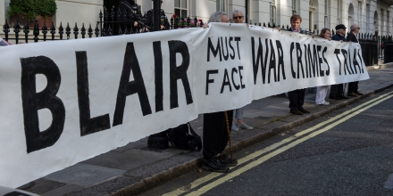 LONDON, ENGLAND - JULY 06:  Protesters hold up a banner reading 'Blair must face war crimes trial' outside the London home of former British Prime Minister Tony Blair on July 6, 2016 in London, England. The Chilcot report on the Iraq war is due to be published today, seven years after it began, which will provide insight into the decision-making behind the conflict.  (Photo by Chris J Ratcliffe/Getty Images)