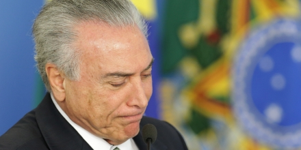 Brazil's acting President Michel Temer attends a ceremony on student financing, at the Planalto presidential palace, in Brasilia, Brazil, Thursday, June 16, 2016. Brazil's acting President Michel Temer rejected allegations that represented the first direct link between him and the massive corruption probe at the state-run oil company Petrobras, denying that he sought campaign funds for his party's mayoral candidate in Sao Paulo as part of a kickback scheme. (AP Photo/Eraldo Peres)