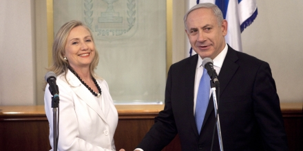 US Secretary of State Hillary Clinton , left, shakes hands with Israeli Prime Minister Benjamin Netanyahu in his office in Jerusalem, Israel, Monday, July 16, 2012. (AP Photo/Abir Sultan, Pool)