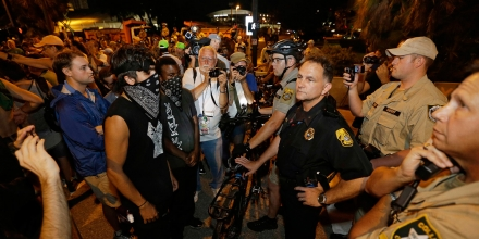 Tampa assistant police chief JA Bennett speaks with protestors, Thursday, Aug. 30, 2012, in Tampa, Fla. Protestors gathered in Tampa to march in demonstration against the Republican National Convention. (AP Photo/Chris O'Meara)