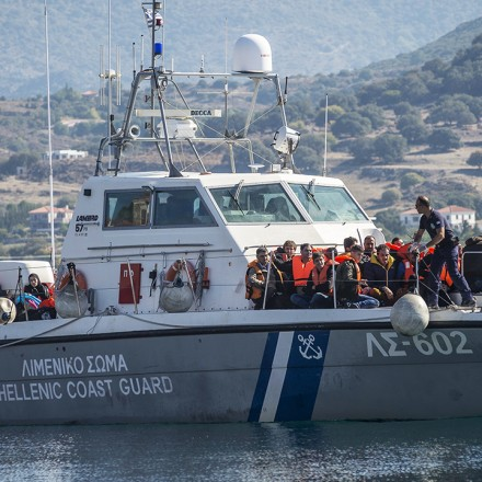 Refugees and Migrants arrive in the Molyvos port, after greek coastguard vessel hits migrant boat on the Greek Island of Lesbos, on October 15, 2015. More than 400,000 refugees, mostly Syrians and Afghans, arrived in Greece since early January while dozens were drowned trying to make the crossing. In total 710,000 have entered the EU through Greece and Italy during the same period, according to the European Agency Frontex border surveillance. The migration issue has caused deep divisions within the European Union, which is trying to set the distribution of migrants among its member countries or limit the flow. (Photo by Antonio Masiello/NurPhoto) (Photo by NurPhoto/NurPhoto via Getty Images)