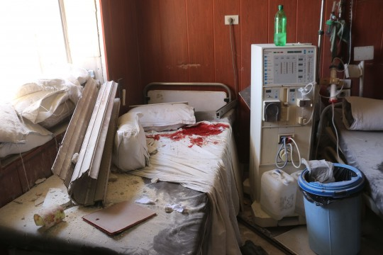 A general view shows the dammage at the Omar bin Abdaziz hospital in the Maadi district of the northern Syrian city of Aleppo after a barrel bomb struck just outside during government air raids on rebel-held districts of the city on July 16, 2016. Air raids on rebel-held districts of Syria's battleground second city of Aleppo killed at least 21 civilians including children, the Syrian Observatory for Human Rights said. / AFP / THAER MOHAMMED (Photo credit should read THAER MOHAMMED/AFP/Getty Images)