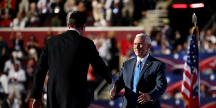 CLEVELAND, OH - JULY 20:  Speaker of the House Paul Ryan shakes the hand of Republican Vice Presidential candidate Mike Pence as he walks on stage to deliver a speech on the third day of the Republican National Convention on July 20, 2016 at the Quicken Loans Arena in Cleveland, Ohio. Republican presidential candidate Donald Trump received the number of votes needed to secure the party's nomination. An estimated 50,000 people are expected in Cleveland, including hundreds of protesters and members of the media. The four-day Republican National Convention kicked off on July 18.  (Photo by Joe Raedle/Getty Images)