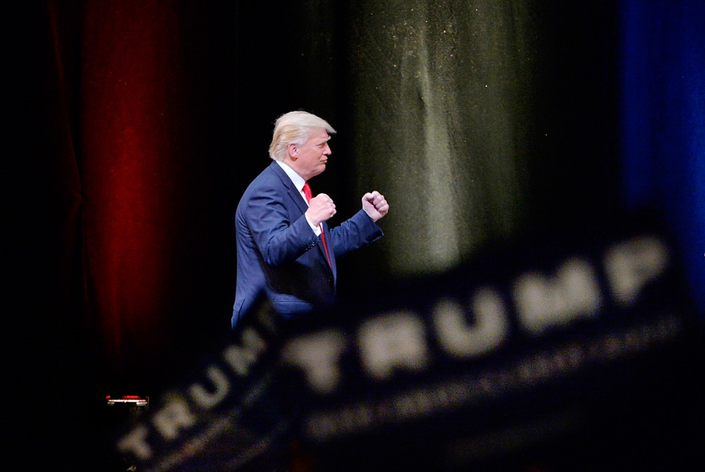 RALEIGH, NC - JULY 5:  Presumptive Republican presidential nominee Donald Trump listens to cheers during a campaign event at the Duke Energy Center for the Performing Arts  on July 5, 2016 in Raleigh, North Carolina. Earlier in the day Hillary Clinton campaigned in Charlotte, North Carolina with President Barack Obama. (Photo by Sara D. Davis/Getty Images)