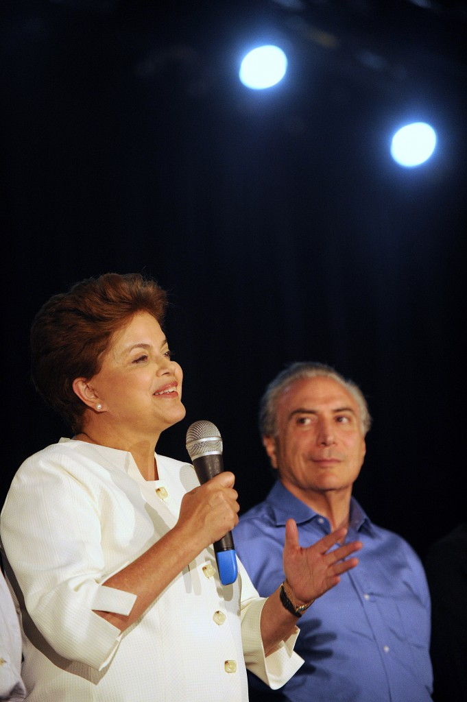 Brazilian presidential candidate for the ruling Workers' Party (PT), Dilma Rousseff and her running mate Michel Temer from the Brazilian Democratic Movement Party (PMDB) speak after receiving the results of the country's general elections, in Brasilia, October 3, 2010. Brazil's presidential election is to go to an October 31 runoff after the ruling party candidate, Dilma Rousseff, won elections on October 3 but not by enough to avoid a second round, the High Electoral Tribunal said.  AFP PHOTO/EVARISTO SA (Photo credit should read EVARISTO SA/AFP/Getty Images)