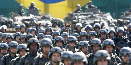The Brazilian Army Command presents the military contingent that will work on the security of the 2013 FIFA Confederations Cup in Brasilia on June 13, 2013.  The security forces will be formed personnel from the Army and the Paramilitary Police. AFP PHOTO/Beto BARATA.        (Photo credit should read BETO BARATA/AFP/Getty Images)