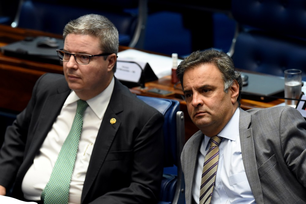 Senator Aecio Neves (R), who heads the PSDB opposition party, sits next to senator Antonio Anastasia, also from the PSDB, during a senate's session to form a committee that will consider whether to impeach President Dilma Rousseff, in Brasilia, on April 25, 2016.&lt;br /&gt;&lt;br /&gt;&lt;br /&gt;&lt;br /&gt;&lt;br /&gt;&lt;br /&gt;&lt;br /&gt;<br /> Brazil's Senate met Monday to form a committee that will consider whether to impeach Rousseff, who has accused her opponents of mounting a constitutional coup. She is accused of illegal government accounting maneuvers, but says she has not committed an impeachment-worthy crime. The Senate committee -- comprising 21 of the 81 senators -- was to debate Rousseff's fate for up to 10 working days before making a recommendation to the full upper house.&lt;br /&gt;&lt;br /&gt;&lt;br /&gt;&lt;br /&gt;&lt;br /&gt;&lt;br /&gt;&lt;br /&gt;<br />  / AFP / EVARISTO SA        (Photo credit should read EVARISTO SA/AFP/Getty Images)