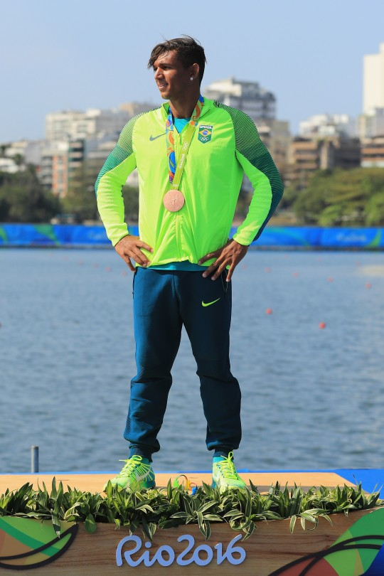 RIO DE JANEIRO, BRAZIL - AUGUST 18:  Bronze medalist Isaquias Queiroz dos Santos of Brazil stands on the podium during the medal ceremony for the Men's Canoe Single 200m event at the Lagoa Stadium on Day 13 of the 2016 Rio Olympic Games on August 18, 2016 in Rio de Janeiro, Brazil.  (Photo by Mike Ehrmann/Getty Images)