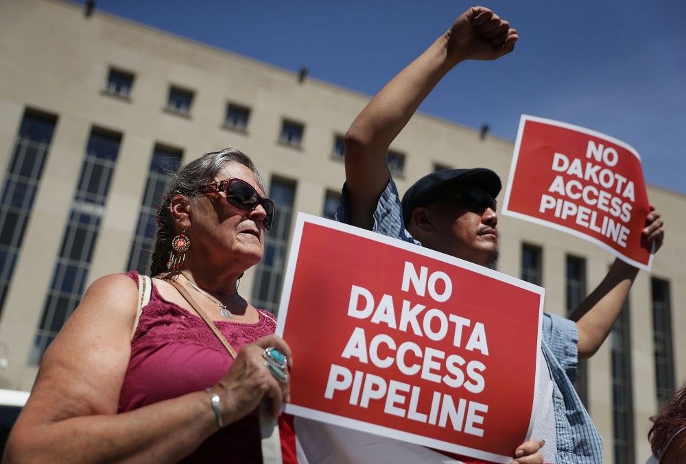 """WASHINGTON, DC - AUGUST 24:  Members of the Red Lake Nation participate during a rally on Dakota Access Pipeline August 24, 2016 outside U.S. District Court in Washington, DC. Activists held a rally in support of a lawsuit against the Army Corps of Engineers """"to protect water and land from the Dakota Access Pipeline,"""" and to call for """"a full halt to all construction activities and repeal of all pipeline permits until formal tribal consultation and environmental review are conducted.""""  (Photo by Alex Wong/Getty Images)"""