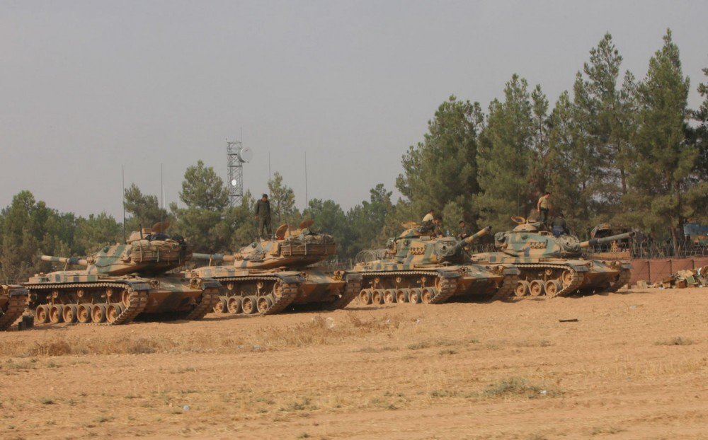 GAZIANTEP, TURKEY - AUGUST 25: Turkish soldiers stand on tanks as they prepare for a military operation at the Syrian border town of Karkamis in the southern region of Gaziantep, on August 25, 2016 in Jarablus, Turkey. The Turkish army launched an offensive operation against ISIS in Syria's Jarablus with its war jets and army troops in coordination with the US led coalition war planes. (Photo by Defne Karadeniz/Getty Images)