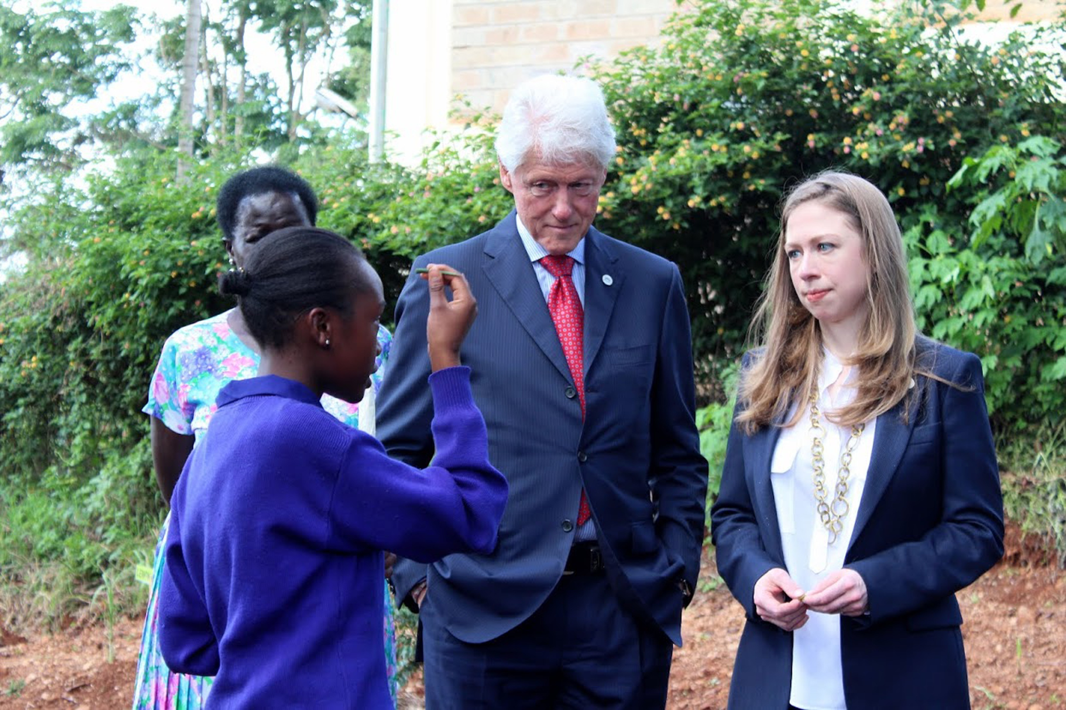 NAIROBI, KENYA - MAY 1: Former US President Bill Clinton (2-R) and his daughter Chelsea Clinton (R) are guided as they visit a herb garden at Farasi Lane primary school in Nairobi, Kenya on 01 May 2015. Former US president Bill Clinton and his daughter Chelsea Clinton are on an African tour to visit several sites of Clinton Foundation projects in Tanzania, Kenya and Liberia concluding with the Clinton Global Initiative Middle East & Africa Meeting (CGI MEA) in Morocco. (Photo by Magdalene Mukami/Anadolu Agency/Getty Images)