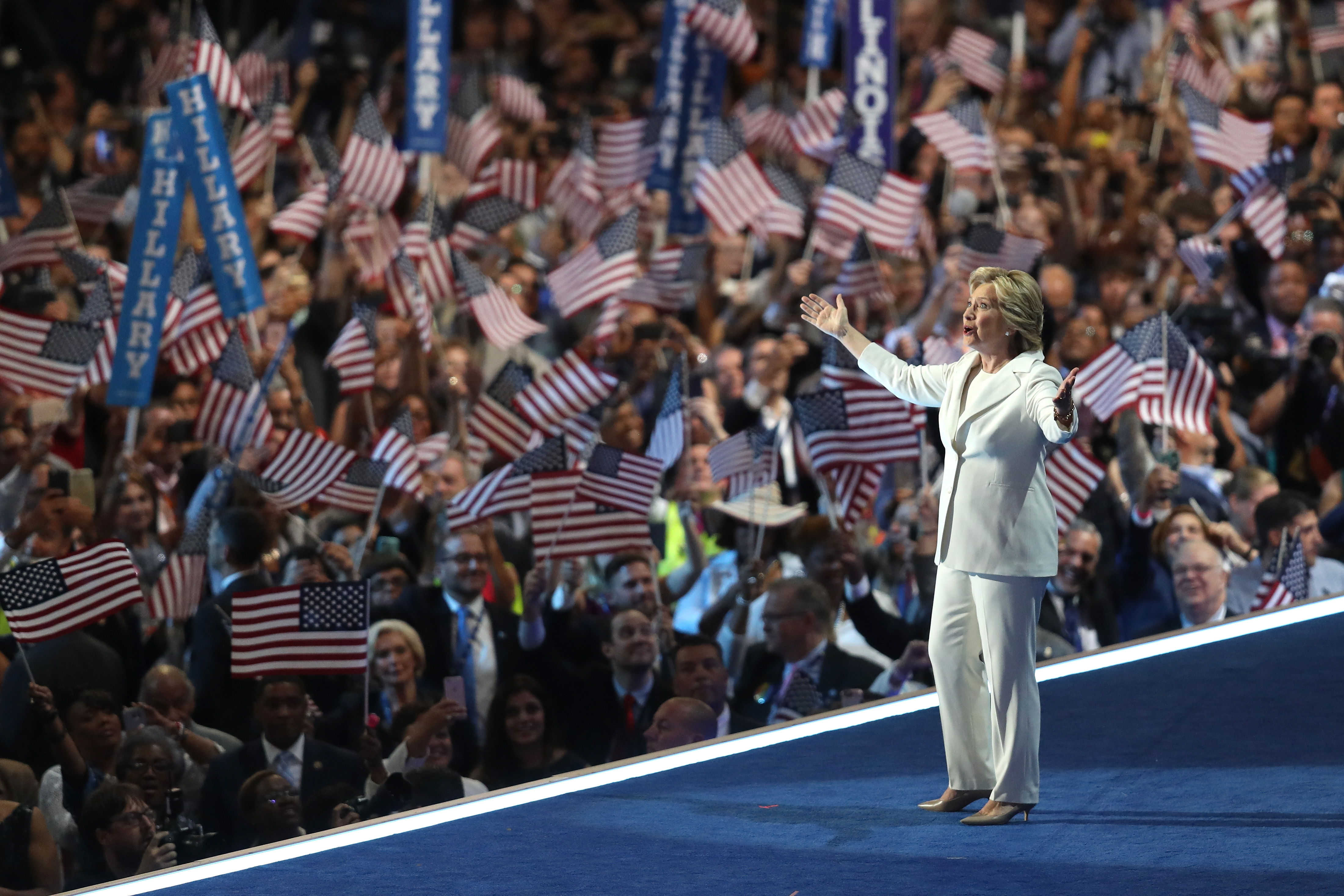 PHILADELPHIA, PA - JULY 28:  Democratic presidential nominee Hillary Clinton acknowledges the crowd as she arrives on stage during the fourth day of the Democratic National Convention at the Wells Fargo Center, July 28, 2016 in Philadelphia, Pennsylvania. Democratic presidential candidate Hillary Clinton received the number of votes needed to secure the party's nomination. An estimated 50,000 people are expected in Philadelphia, including hundreds of protesters and members of the media. The four-day Democratic National Convention kicked off July 25.  (Photo by Joe Raedle/Getty Images)