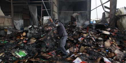 Employee look through the damage at the Al-Aqel food factory that makes potato chips in Yemen's rebel-held capital Sanaa, after it was hit by a Saudi-led coalition strike on August 9, 2016, killing over a dozen workers, medics said. Abdullah al-Aqel the director of the factory said it is located near a military equipment maintenance centre that was targeted in the raids. / AFP / MOHAMMED HUWAIS (Photo credit should read MOHAMMED HUWAIS/AFP/Getty Images)