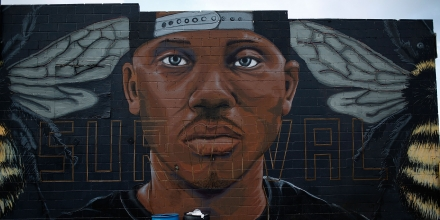 BALTIMORE, MD - AUGUST 10:  A mural of Freddie Gray near the location where he was arrested is shown August 10, 2016 in Baltimore, Maryland. The Justice Department is scheduled to release a report later this morning highly critical of the Baltimore Police Department for systematically stopping, searching and arresting the city's black residents, frequently without grounds for doing so.  (Photo by Win McNamee/Getty Images)