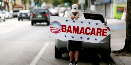 MIAMI, FL - FEBRUARY 05:  Pedro Rojas holds a sign directing people to an insurance company where they can sign up for the Affordable Care Act, also known as Obamacare, before the February 15th deadline on February 5, 2015 in Miami, Florida. Numbers released by the government show that the Miami-Fort Lauderdale-West Palm Beach metropolitan area has signed up 637,514 consumers so far since open enrollment began on Nov. 15, which is more than twice as many as the next large metropolitan area, Atlanta, Georgia.  (Photo by Joe Raedle/Getty Images)