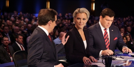 DES MOINES, IA - JANUARY 28:  Moderators Chris Wallace (L) pats on the shoulder of Megyn Kelly (2nd L) as they wait with Bret Baier (R) for the beginning of the Fox News - Google GOP Debate January 28, 2016 at the Iowa Events Center in Des Moines, Iowa. Residents of Iowa will vote for the Republican nominee at the caucuses on February 1. Donald Trump, who is leading most polls in the state, decided not to participate in the debate.  (Photo by Alex Wong/Getty Images)