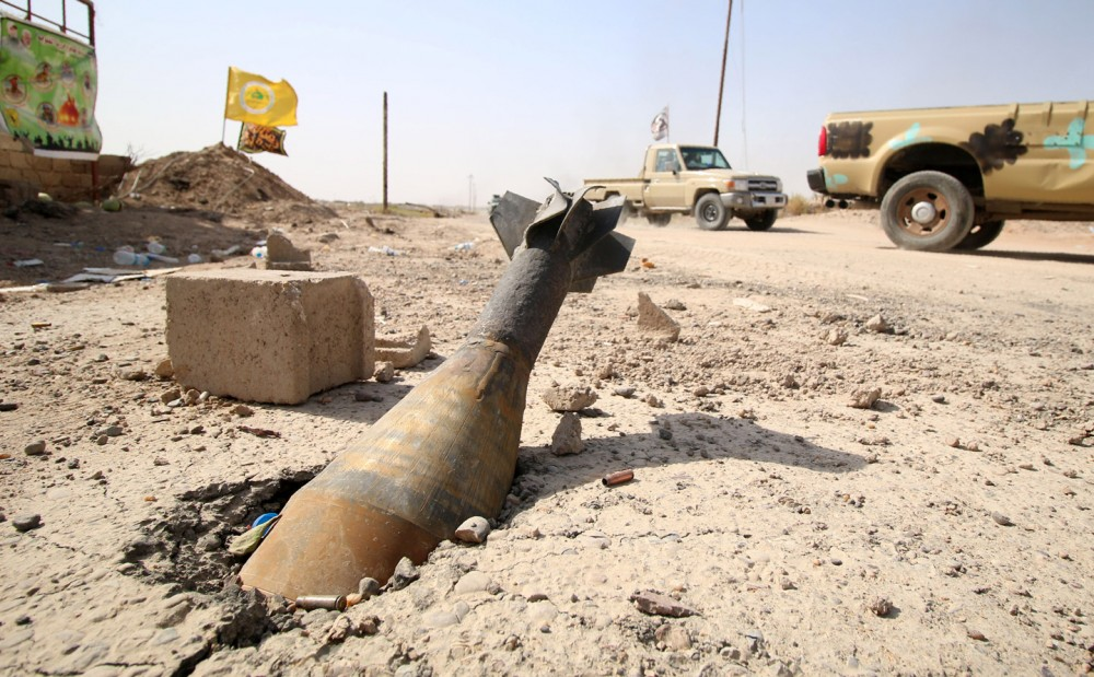 TOPSHOT - An unexploded mortar shell is seen half buried in the ground in Fallujah, 50 kilometres (30 miles) from the Iraqi capital Baghdad, after Iraqi forces retook the embattled city from the Islamic State group on June 26, 2016.</p> <p>Iraqi Prime Minister Haider al-Abadi urged all Iraqis to celebrate the recapture of Fallujah by the security forces and vowed the national flag would be raised in Mosul soon. While the battle has been won, Iraq still faces a major humanitarian crisis in its aftermath, with tens of thousands of people who fled the fighting desperately in need of assistance in the searing summer heat.</p> <p> / AFP / HAIDAR MOHAMMED ALI        (Photo credit should read HAIDAR MOHAMMED ALI/AFP/Getty Images)