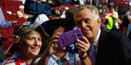 PHILADELPHIA, PA - JULY 26: Virginia governor and former Democratic National Committee Chair Terry McAuliffe poses for a photo with delegates prior to the start of the second day of the Democratic National Convention at the Wells Fargo Center, July 26, 2016 in Philadelphia, Pennsylvania. An estimated 50,000 people are expected in Philadelphia, including hundreds of protesters and members of the media. The four-day Democratic National Convention kicked off July 25. (Photo by Aaron Bernstein/Getty Images)