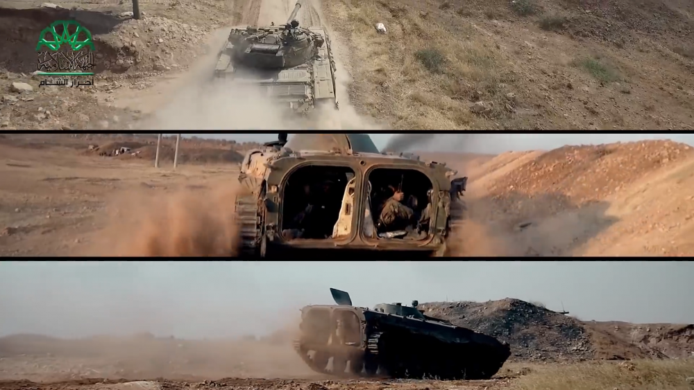 """Scene from """"Rage Wind"""" film showing militia members operating armored vehicles."""