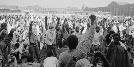 Inmates at Attica State Prison in Attica, New York raise their fists in a show of unity on Sept. 1971, during the Attica uprising, which took the lives of 43 people.
