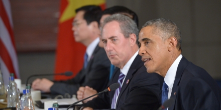 US President Barack Obama (R) speaks during a meeting with leaders from the Trans-Pacific Partnership at the US Embassy in Beijing on November 10, 2014 in Beijing. At left is US Trade Representative Mike Froman. Top leaders and ministers of the 21-member APEC grouping are meeting in Beijing from November 7 to 11. AFP PHOTO/Mandel NGAN        (Photo credit should read MANDEL NGAN/AFP/Getty Images)