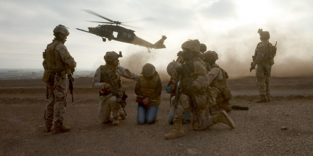 Chile and U.S. Special Forces wait for a U.S. Army MH-60 Blackhawk to evacuate two simulated hostages July 22, 2016 during a training rescue operation as part of exercise Southern Star in Antofagasta, Chile. USSF assigned to Special Operations Command South conducted simulated operations under the command and control of a Chile and U.S. combined operational headquarters. (U.S. Army Photo by Staff Sgt. Osvaldo Equite/Released)